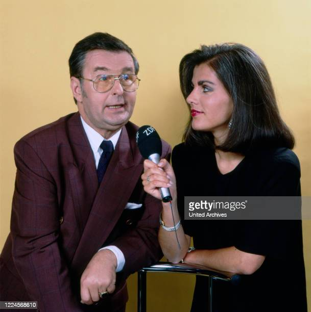 The German television presenter Birgit Schrowange with guest and actor Ernst Hilbisch in the ZDF programme 'Wiedersehen macht Freude' where treasures...