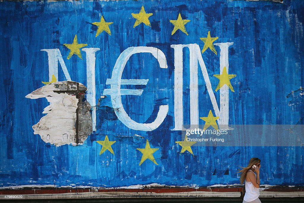 The German word 'Nein' which means 'No' sits on graffiti art displaying the European Union (EU) flag and a euro symbol on July 8, 2015 in Athens, Greece. Eurozone leaders have offered the Greek government one more chance to propose a viable solution of it's debt or face the possibilty of a likely exit from the euro.