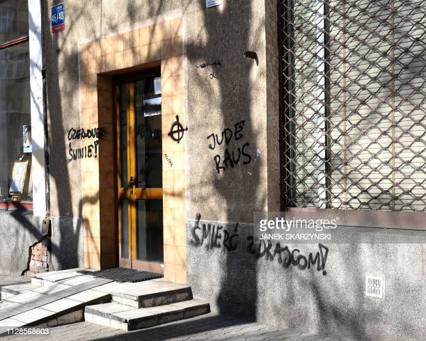 The German words Jude Raus are written on the building of the Citizens of Poland movement on February 26 2019 in Warsaw Graffiti of a swastika and...