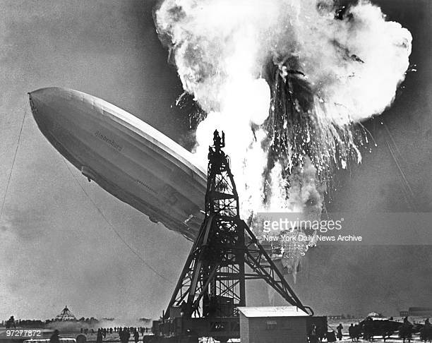 The German zeppelin Hindenburg explodes at the mooring tower at Lakehurst New Jersey upon its arrival on a commercial flight from Germany The ball of...