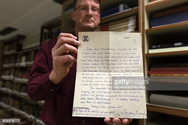 The Germanborn archivist in charge of the Zweig collections for Israels National Library Stefan Litt shows a letter sent by Austrian author Stefan...