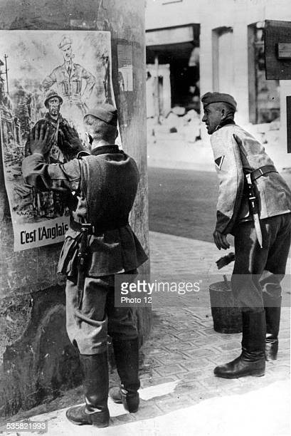 The Germans at Dormans France looking at an antiBritish poster August 17 1940