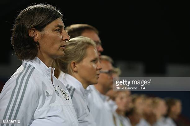 AZ ZARQA' JORDAN OCTOBER 07 The Germany Coach Anouschka Bernhard sings the national anthem prior to the FIFA U17 Women's World Cup Jordan 2016 Group...