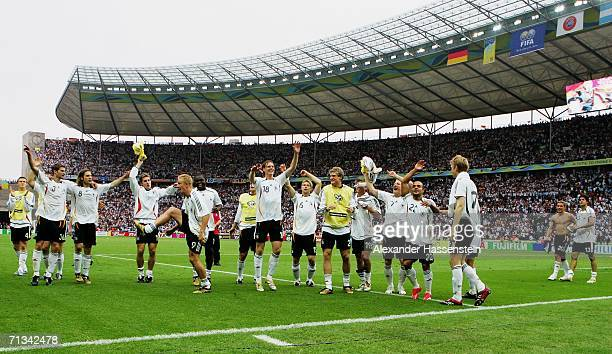 The Germany players celebrate following their team's victory in a penalty shootout at the end of the FIFA World Cup Germany 2006 Quarter-final match...