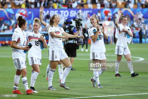 The Germany players celebrate victory following the 2019 FIFA Women's World Cup France group B match between South Africa and Germany at Stade de la...