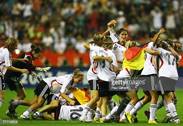 The Germany team celebrate after winning at the end of the Women's World Cup 2007 Final between Brazil and Germany at Shanghai Hongkou Football...