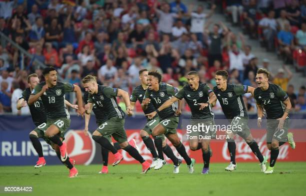 The Germany team celebrate their side winning a penalty shoot out during the UEFA European Under21 Championship Semi Final match between England and...