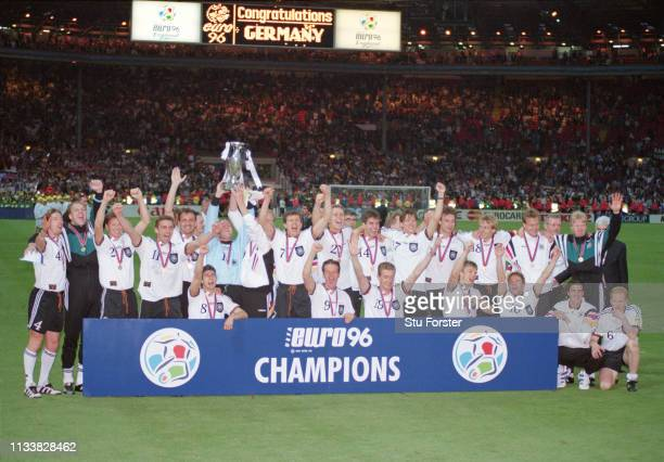 The Germany team celebrate victory after the 1996 UEFA European Championships Final against Czech Republic at Wembley Stadium on June 30, 1996 in...