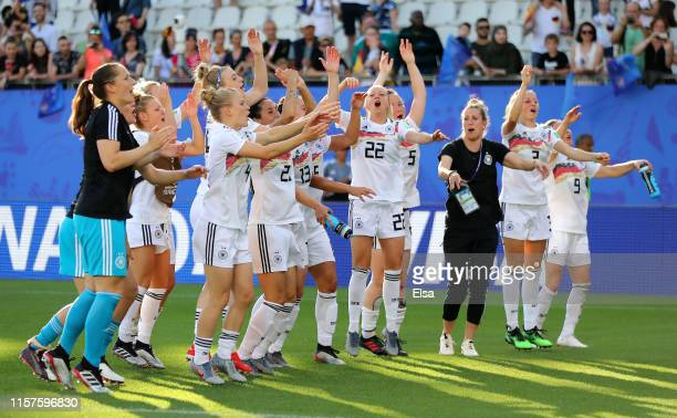 The Germany team celebrate victory after the 2019 FIFA Women's World Cup France Round Of 16 match between Germany and Nigeria at Stade des Alpes on...