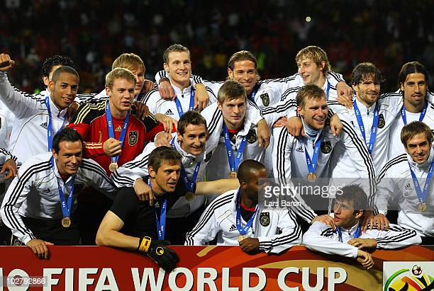 The Germany team celebrate victory and third place following the 2010 FIFA World Cup South Africa Third Place Playoff match between Uruguay and...