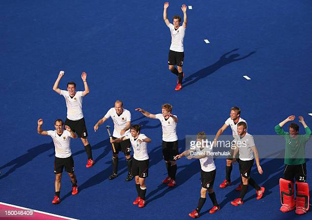 The Germany team celebrate victory at the end of the Men's Hockey Semi Final match between Australia and Germany on Day 13 of the London 2012 Olympic...