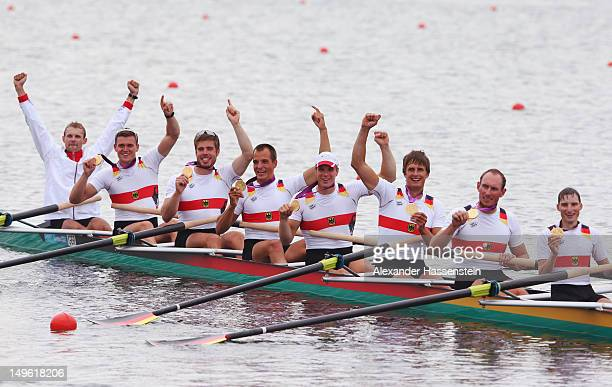 The Germany team celebrate with their medals after winning gold in the Men's Eight Final on Day 5 of the London 2012 Olympic Games at Eton Dorney on...