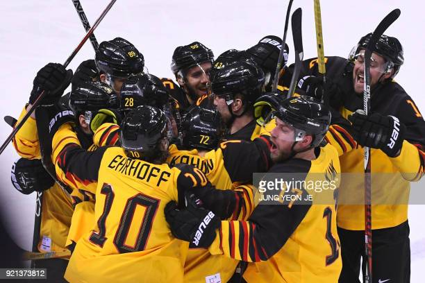 The Germany team celebrates after Germany's Yannic Seidenberg scored the winning goal in overtime in the men's playoffs qualifications ice hockey...