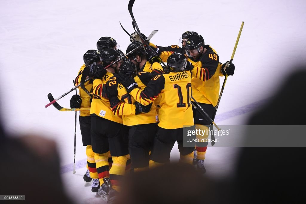 TOPSHOT - The Germany team celebrates after Germany's Yannic Seidenberg scored the winning goal in overtime in the men's play-offs qualifications ice hockey match between Switzerland and Germany during the Pyeongchang 2018 Winter Olympic Games at the Kwandong Hockey Centre in Gangneung on February 20, 2018. / AFP PHOTO / Jung Yeon-je