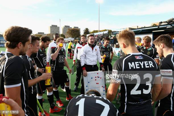 The Germany team get instructions during a break in play during the Group B match between Germany and Ireland on day five of the FIH Hockey World...