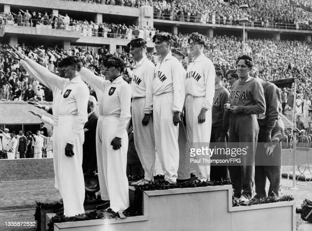 The Germany team giving the Nazi salute, the Great Britain team , and USA team on the podium after the Men's 4x400 metres relay event of the 1936...