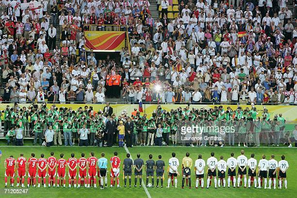 The Germany team line up for the national anthems as photographers take pictures before the FIFA World Cup Germany 2006 Group A match between Germany...