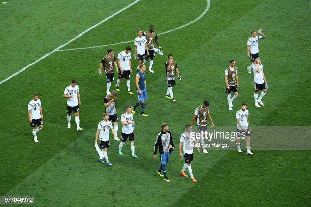 The Germany team look dejected as they walk across the pitch following their sides defeat in the 2018 FIFA World Cup Russia group F match between...