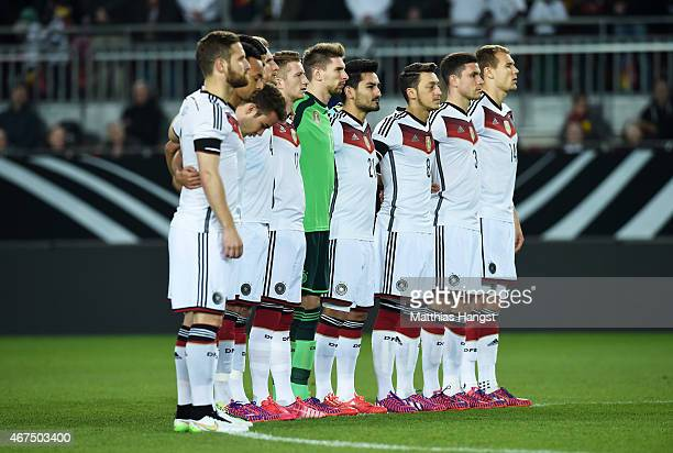 The Germany team observes a minutes silence in remembrance of the victims of Germanwings flight 4U9525 prior to kickoff during the International...