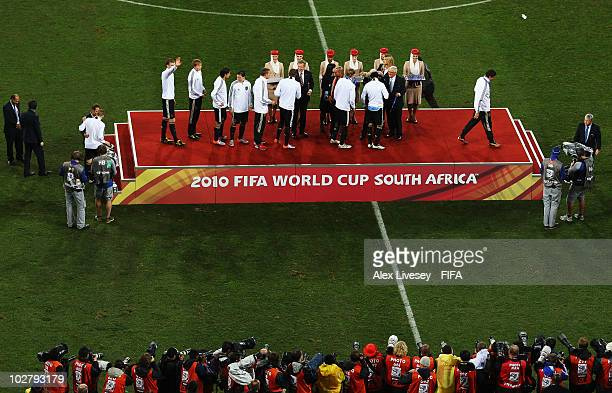 The Germany team receive their bronze medals after coming third during the 2010 FIFA World Cup South Africa Third Place Playoff match between Uruguay...