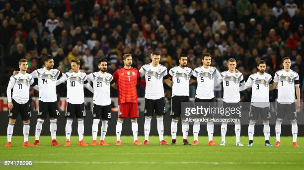 The Germany team take part in a minute of silence in memory of Hans Schaefer prior to the international friendly match between Germany and France at...