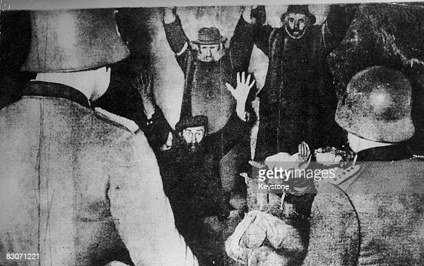 The Gestapo arrest a group of Jewish men hiding in a cellar in Poland circa 1939 Possibly a staged German propaganda photo