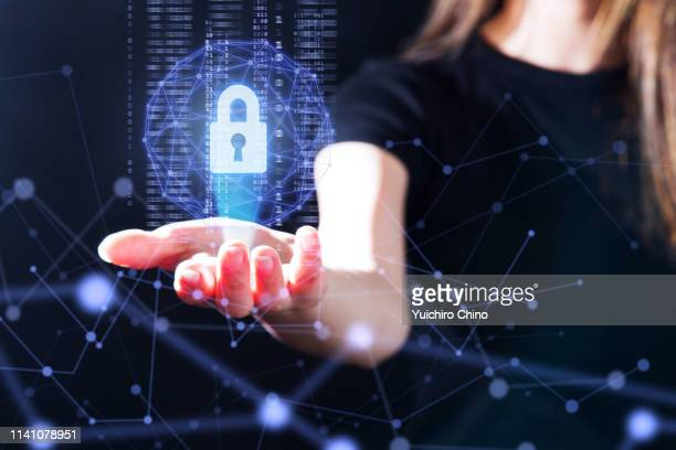 the gesture interface technology with the security key lock icon and binary - security_(finance) stock pictures, royalty-free photos & images