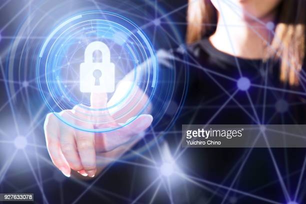 the gesture interface technology with the security key lock icon - private stock pictures, royalty-free photos & images