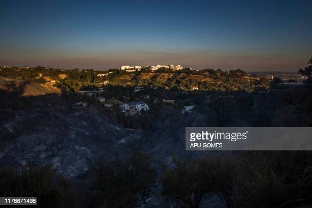 The Getty Center is seen behind hills completely burned by the Getty Fire in Brentwood California on October 28 2019 More than 1000 firefighters...