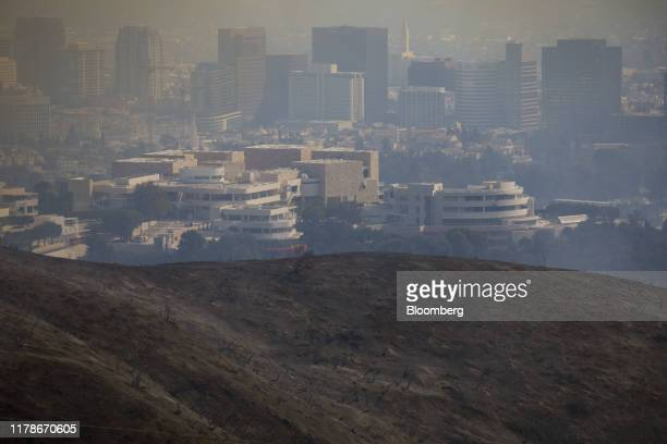 The Getty Center stands during a brush fire in Los Angeles California US on Monday Oct 28 2019 A fastmoving brush fire known as the Getty Fire has...