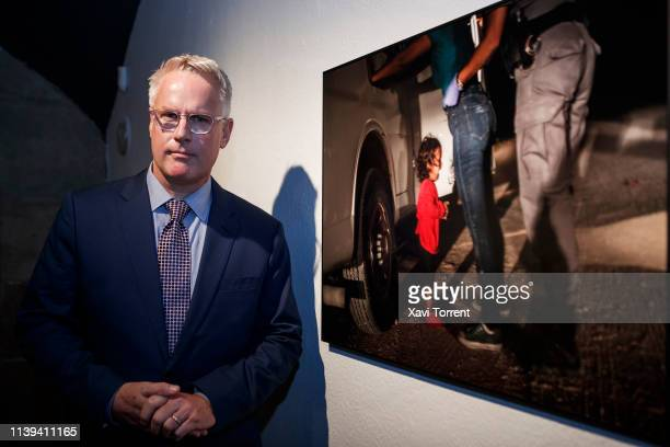 The Getty Images photographer and winner of the World Press Photo 2019 John Moore poses for a portrait in front of the winning photo during the...