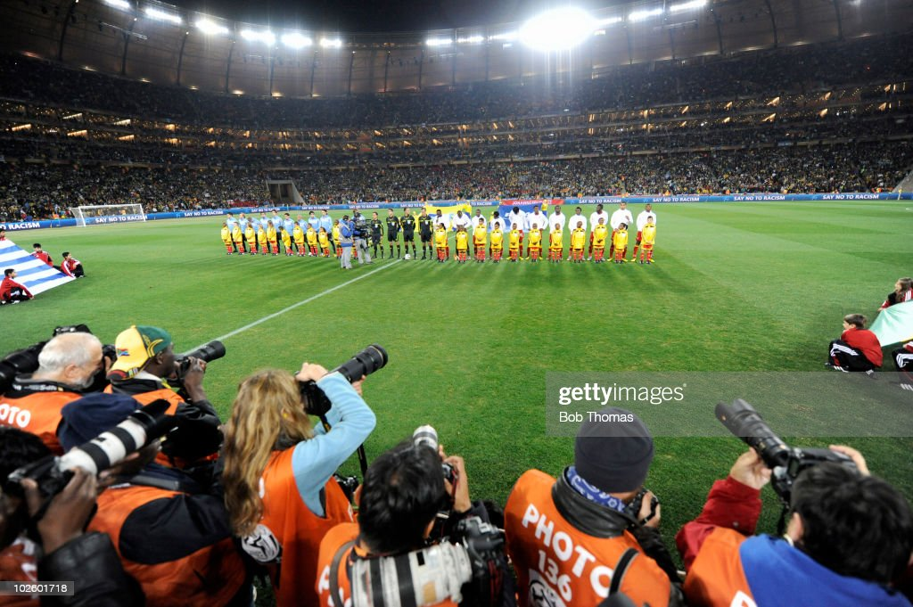 The Ghana and Uruguay teams line up before the start of the 2010 FIFA World Cup South Africa Quarter Final match between Uruguay and Ghana at the Soccer City stadium on July 2, 2010 in Johannesburg, South Africa. The match ended 1-1 after extra-time. Uruguay won 4-2 on penalties.
