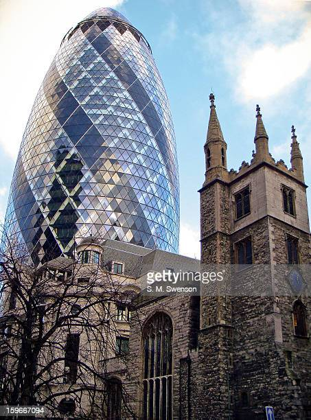 CONTENT] The Gherkin skyscraper with a 16th Century church in the foreground Taken in the City of London on a partly cloudy afternoon on November 9...