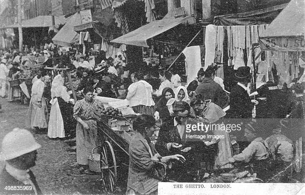 'The Ghetto London' c1890 Postcard showing a market in the East End of London Between 1881 and 1914 two million Jews left Eastern Europe fleeing...