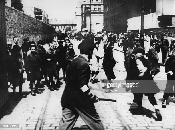 The Ghetto of Warsaw before the uprising The Jewish police are separeting the population of the Ghetto The wall is separating the Ghetto from the...