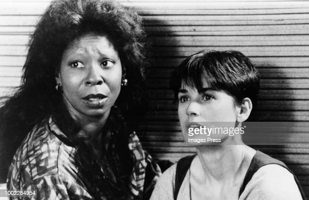 """The ghost of Sam Wheat is able to communicate with Molly Jensen through psychic Oda Mae Brown in the suspense thriller """"Ghost"""", directed by Jerry..."""