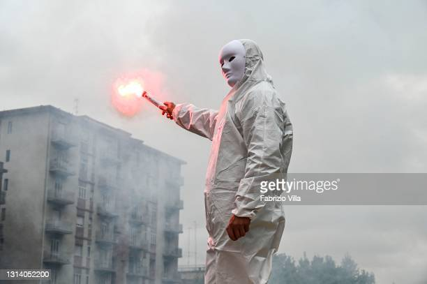 """The """"Ghosts of the past"""", including restaurateurs, VAT numbers and gym owners gather for a flash mob protest, wearing white masks and overalls, to..."""