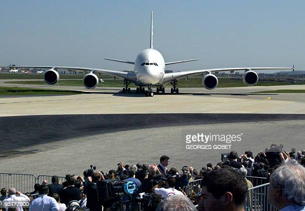 The giant doubledecker Airbus A380 the world's largest commercial airliner lands 27 April 2005 on the tarmac of ToulouseBlagnac's airport In a...