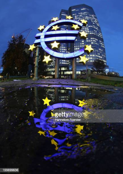 The giant Euro symbol reflected outside the headquarters of the European Central Bank on November 5 2012 in Frankfurt Germany Analysts are predicting...
