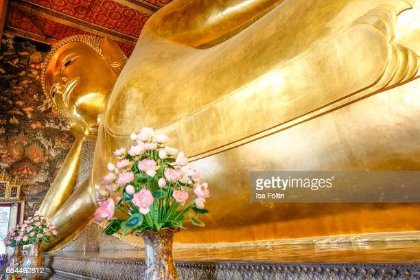 The giant golden reclining Buddha in the Wat Pho temple on March 16 2017 in Bangkok Thailand