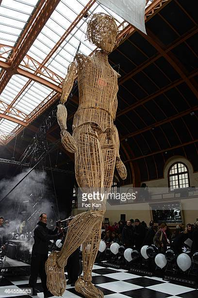 The giant puppet walks the runway during the Franck Sorbier show as part of Paris Fashion Week Haute Couture Spring/Summer at the Caserne De La Garde...
