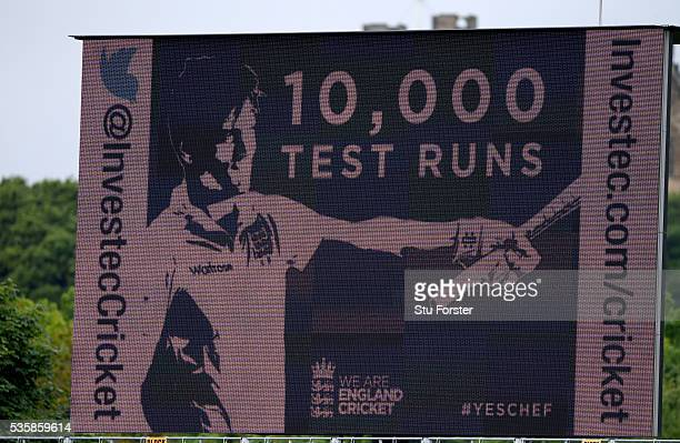 The giant scoreboard shows England batsman Alastair Cook after reaching 10,000 test runs during day four of the 2nd Investec Test match between...