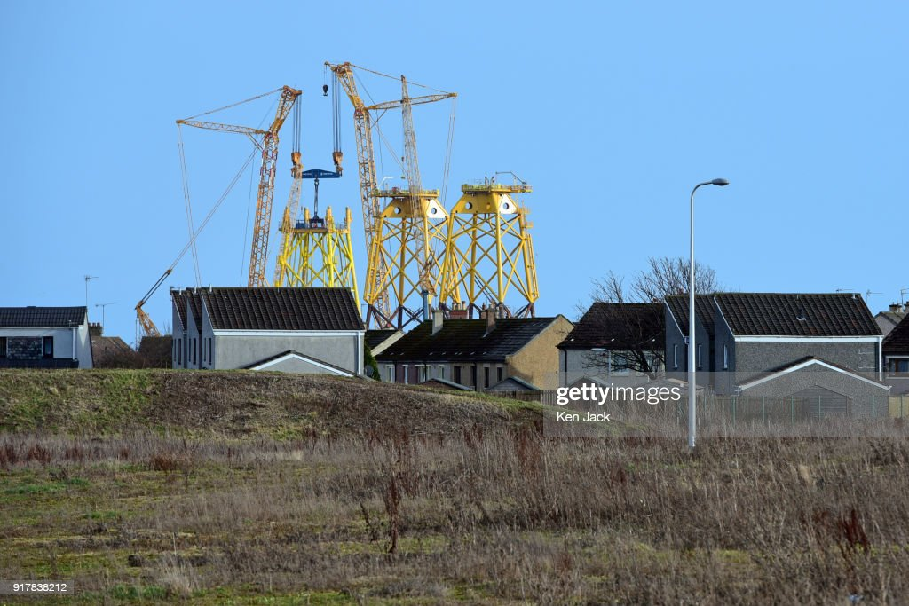 The giant steel structures under construction at the BiFab Methil Yard in Fife where many of the workforce were to be issued with redundancy notices today, dominate the town of Buckhaven across some waste ground, on February 13, 2018 in Buckhaven, Scotland. The company faced possible administration following disputes over a contract to supply large-scale metal jackets for offshore wind turbines in 2017, but were enabled to continue trading by a deal brokered by the Scottish Government, however the contract is now nearing completion.