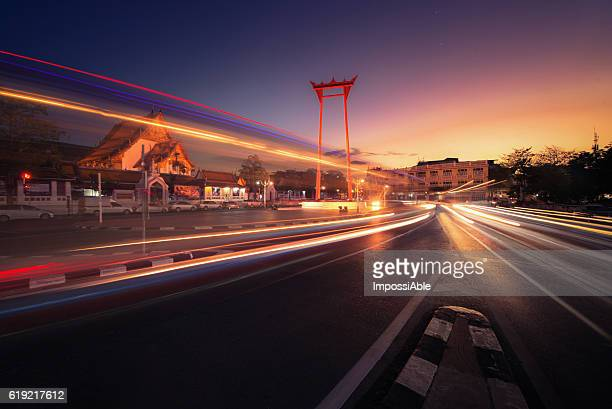 the giant swing and suthat temple at sunset - impossiable stock pictures, royalty-free photos & images