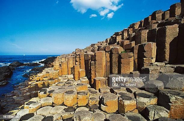 The Giant's Causeway, an area of interlocking basalt columns on the coast near Bushmills, Northern Ireland, United Kingdom.