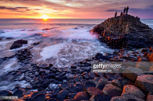 the giant's causeway and causeway coast world heritage site by unesco - giant's causeway stock pictures, royalty-free photos & images