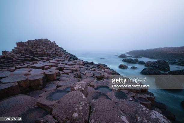 the giant's causeway, northern ireland, uk. - international landmark stock pictures, royalty-free photos & images