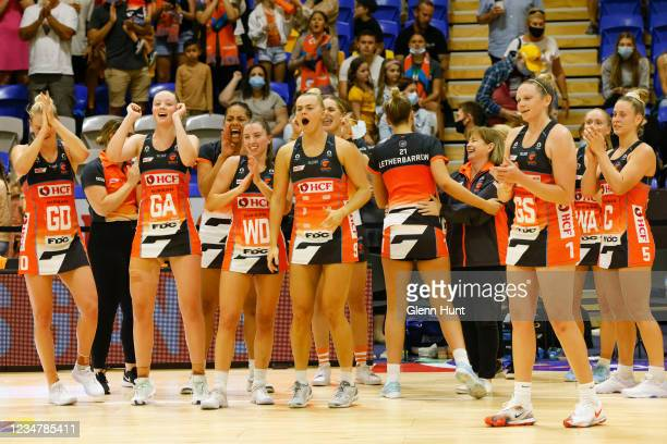 The Giants celebrate their win during the Preliminary Final Super Netball match between the GWS Giants and West Coast Fever at University of Sunshine...