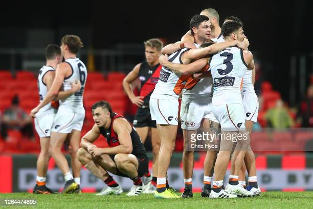 The Giants celebrate winning the round 10 AFL match between the Essendon Bombers and the Greater Western Sydney Giants at Metricon Stadium on August...