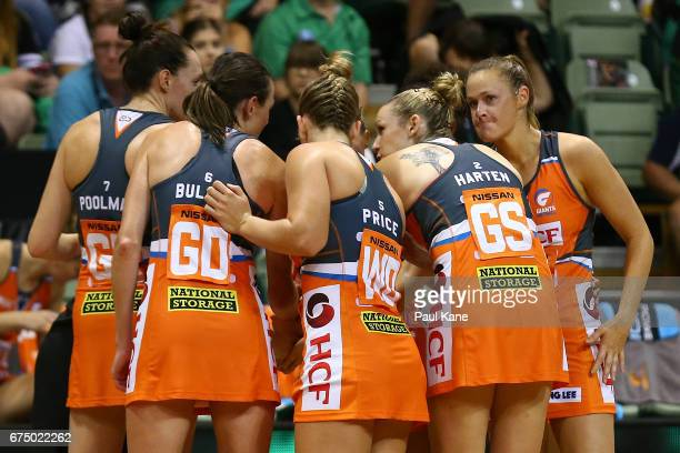 The Giants huddle during the round 10 Super Netball match between the Fever and the Giants at HBF Stadium on April 30 2017 in Perth Australia